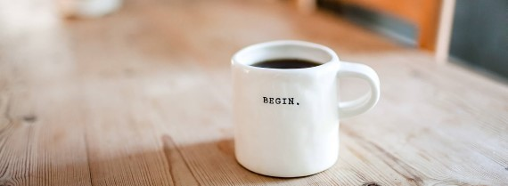 Image of mug saying 'begin'